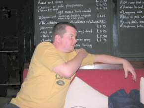 Chris Fisher partly hides the specials board