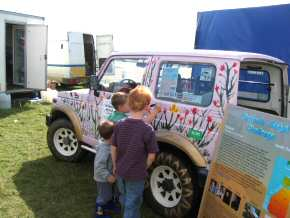 young sponsors add floral decorations to the jeep in its new pink colour scheme