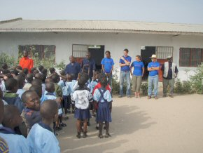 The teams and the children outside the Kings Kid school buildings