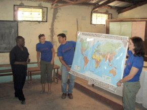 Guillermo and Clare with the world map