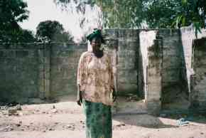 Saloum Nursery headmistress stands outside the defunct toilets
