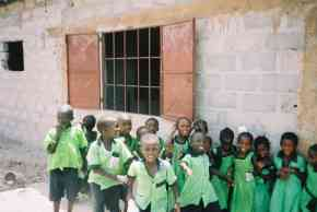 children outside the partly refurbished classroom at Saloum