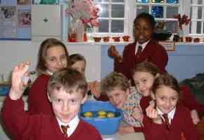 children in their class at the Dame Tipping School