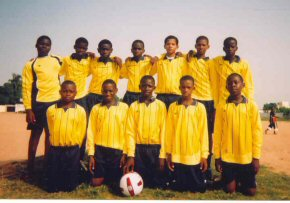 Ndow UBS football team in kit supplied by Christ's Hospital