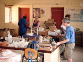 unpacking - Chris with Abdoulie, Anne and Wandifa at Gambia College