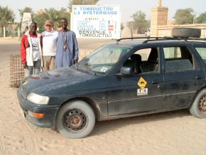 Tim with the new owners of the car in Timbuktu