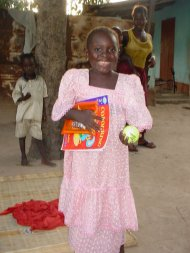 another sponsored child, Fatou, is delighted with her good fortune at being sponsored