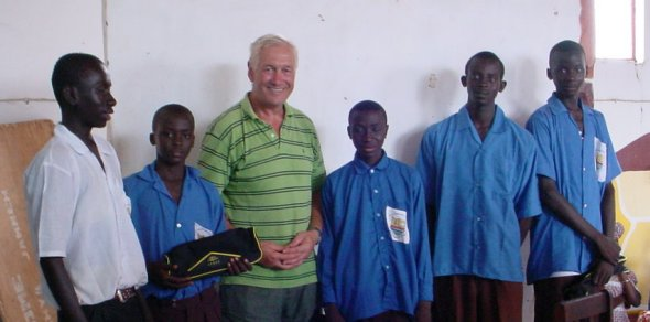 Ian with five boys who would have been excluded from school for non-payment of fees, but will now be able to complete their Grade 9 examinations