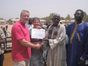 Headteacher, Mr Fatty, presenting Sue and Phil with a Certificate of Appreciation