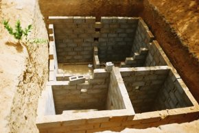 underground effluent chambers being constructed with concrete blocks in a deep pit