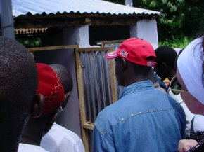 a closer view as people look at the new toilet block