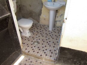 new tiled floors in one of the two toilets