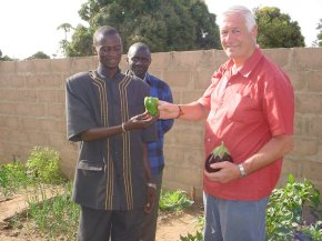 Ian is presented with a green pepper by the headmaster