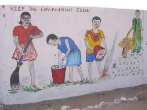 a painting showing pupils clearing up rubbish with the message 'keep the environment clean'