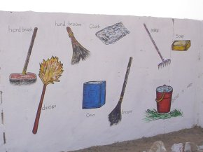 a painting of mops brushes and other tools for keeping the environment clean