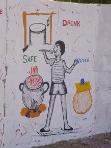 a panel about safe water, showing water coming from a well, being boiled and then covered