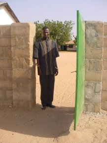 Mr Giteh, the headmaster, stands in one of the gateways in the wall