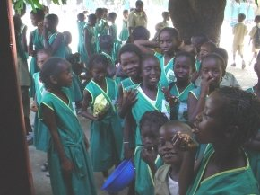a group of the children in their green uniforms
