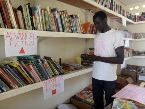 Abdoul in the library, selecting books to take to his class