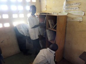 students arranging the books in a classroom library